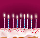 Blue and pink candles on a birthday cake Stock Images