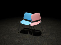 Blue and Pink Chair bright illuminated leaning against each Royalty Free Stock Photography