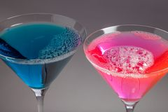Blue and pink cocktails. Close-up of fun bubbly party drinks. Neon blue and pink cocktails. Close-up of fun bubbly party drinks. Vivid colors and surface bubbles stock photos