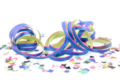Blue pink colored party streamer. With confetti over white Royalty Free Stock Photography