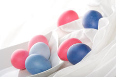 Blue and pink easter eggs on white background Royalty Free Stock Images