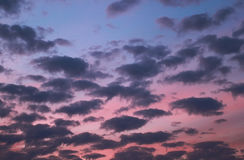 Blue and pink evening sky during a sunset cloud cover Stock Photo