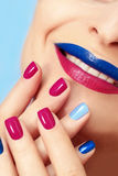 Blue pink fashion nails and lips. Royalty Free Stock Image