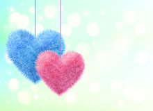 Blue and pink fluffy hearts pair on blue bokeh Royalty Free Stock Photography