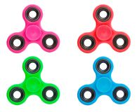 Blue pink green red spinners stock photos