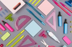 Blue, pink, green, yellow office stationery collection on grey background, top view, pattern. Blue, pink, green, yellow office stationery collection on grey royalty free stock image