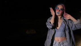Girl in colored sunglasses is dancing stock video footage