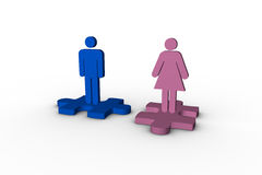 Blue and pink human figures over jigsaw pieces separated Royalty Free Stock Photos
