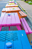 Blue Pink and Orange Picnic Tables Royalty Free Stock Images
