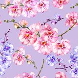 Blue and pink orchid flowers on light lilac background. Seamless floral pattern. Watercolor painting. Hand drawn illustration. Can be used as a background, for vector illustration