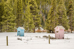 Blue and Pink Outhouses Stock Photography