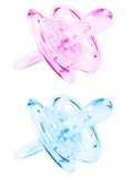 Blue and pink pacifier Royalty Free Stock Photo