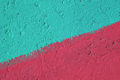 Blue and pink painted concrete wall texture Stock Images