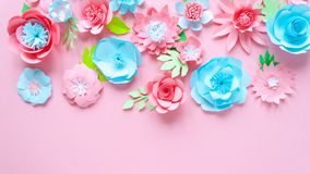 Blue and pink paper flowers on the pink background stock image