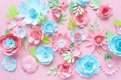 Blue and pink paper flowers on the pink background royalty free stock photography