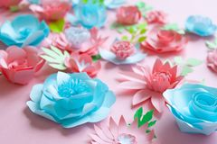 Blue and pink paper flowers on the pink background stock photos