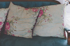 blue and pink pillow on blue old style retro vintage sofa Stock Photo