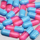 Blue and pink pills Stock Image