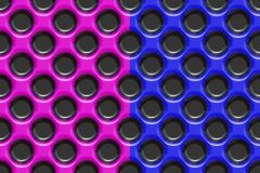 Blue and pink plastic with holes. Blue and pink plastic material with black holes Stock Image