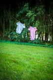 Blue and Pink rompers hanging in the forest Stock Photography