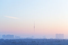 Blue pink sky over city and TV tower in sunrise Royalty Free Stock Photography