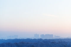Blue and pink sky over city in winter sunrise Royalty Free Stock Photos