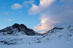 Blue and pink sky in snow mountains at sunset. Somewhere at Altay royalty free stock photo
