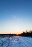 Blue and pink sky on sunset and snow road Stock Photography