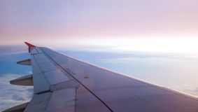 Blue and pink sky with sunset view from airplain window. Picture shoot from airplain window Royalty Free Stock Image