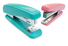 Blue and pink staplers. With clipping path Royalty Free Stock Photography