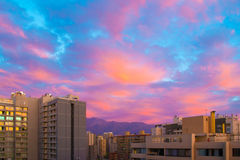 Blue and pink sunset. Sunset with blue sky and pink clouds above buildings Stock Photo