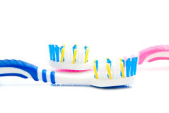 Blue and pink toothbrushes on white Royalty Free Stock Photo