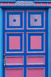 Blue and pink wooden window of a colonial house front in Salento Royalty Free Stock Photos