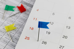 Blue Pins to Wildcats on the calendar beside the number of twent Royalty Free Stock Photo