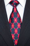 Blue Pinstripe suit and red/blue tie Royalty Free Stock Photo