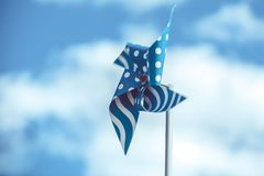 Blue pinwheel on sky. Background with few clouds Royalty Free Stock Photography