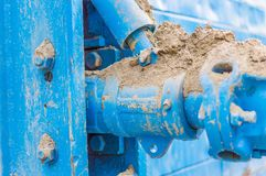 Blue pipe line on iron wall Royalty Free Stock Image