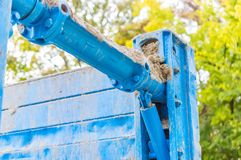 Blue pipe line on iron wall Royalty Free Stock Photography