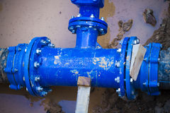 Blue pipe in the street damaged Stock Photo