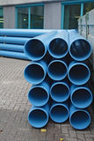 Blue pipes. Blue pvc pipes stacked four by three, seen from the front stock photography
