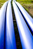 Blue pipes. In construction site stock images