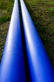 Blue pipes. In construction site stock photo