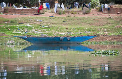 A blue pirogue on the river Niger Royalty Free Stock Photos