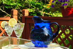 Blue pitcher and drinks Stock Photography