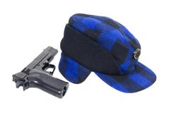 Blue plaid hunters Hat and gun Royalty Free Stock Photos