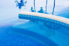 Blue planches in the pool with water royalty free stock photo