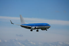 Blue plane approaching runway Royalty Free Stock Photography
