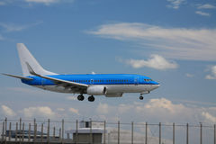 Blue plane approaching runway Royalty Free Stock Photos