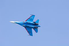 Blue plane in blue sky. Aerobatic team - Russian Knights- SU27 Royalty Free Stock Photography