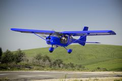 A blue plane manned by student and flight instructor of a class flight practice. Conceptual image stock photography